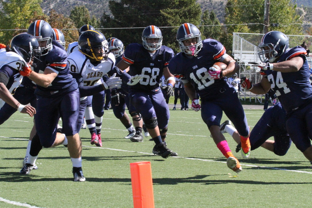 Nicholas West, a wide receiver for Snow College's football team, rushes the ball for a touchdown against Phoenix College. Photo by Corey Greenhalgh