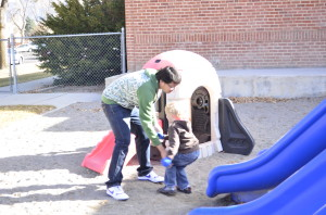 Playing outside is a great way to get the energy out of the kids at the Child Development Lab and JiaHuan Chen is there to help supervise. Photo by Crystal Snow