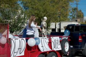 Members of the Dead Cat's Society throw out candy at this year's homecoming parade. Photo Courtesy of Dead Cat's Society
