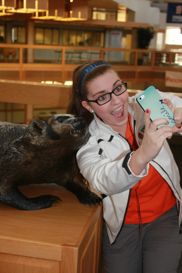 Aubrey puts her perfect selfie look to use and poses with a badger statue in the GSC.  Photo by Kaitlyn Bown