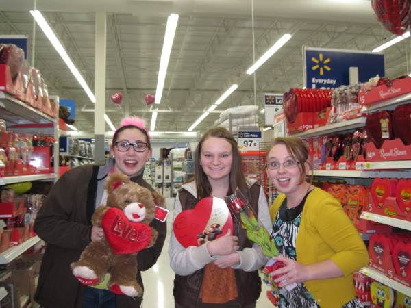 Victoria Magoon, Ashley Gudmundson, and Whitnee Norman show that they can have fun on Valentines Day without a date. Photo by Olivia Bailey.
