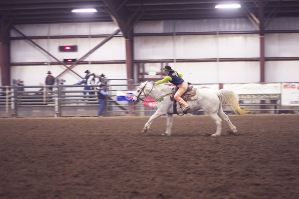 Shawnee Sagers races out of the gate during the goat tying event during the Snow College Rodeo. Photo by Tyler Aldous