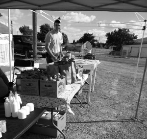 Hunter Palmer works at the Farmer's Market in Sterling Photo by: Savannah Palmer
